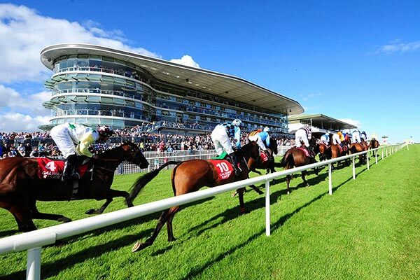 Galway Races finishing post with horses charging uphill